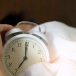 photo-of-person-holding-alarm-clock-1028741-1
